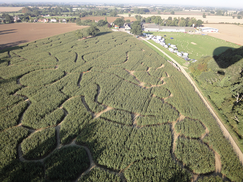 Every year Blake House Craft Centre grows a field of maize and in late summer it is tall enough to be cut to create a maze for visitors to walk in. There have been some great designs over the years and here are just a few that we have snapped on our Essex balloon rides from Blake House over the years.