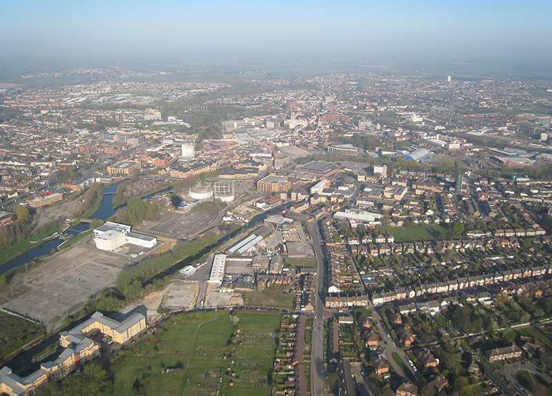 Aerial view of Chelmsford on a morning hot air balloon ride looking from the South East. You can see the railway viaduct with the grounds of Writtle College around it, the River Chelmer and the River and Lockside Marina in this aerial picture
