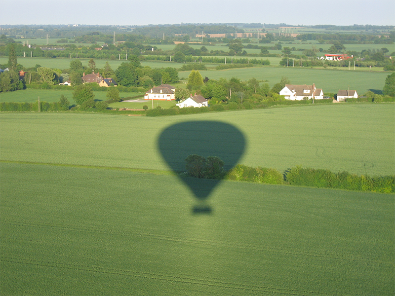 Taking pictures of the balloon shadow and the aerial view is popular on Essex Balloon Flights and Rides