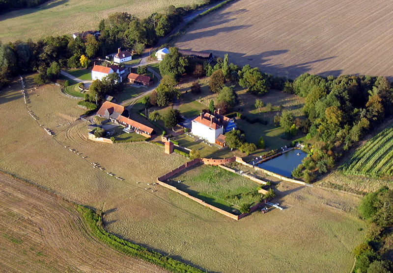 There are many fine country houses in Essex, creating ideal retreats for the financially successful from the City of London. This house was clearly a Manor house in times past, with farm buildings and cottages for those in its employ, a walled garden and a fishing lake. Aerial views such as this are often experienced on our hot air ballon flights over the Essex countryside