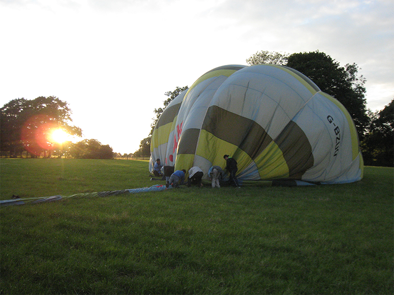 After the Essex balloon flight landing comes the fun of packing the balloon away in its bag