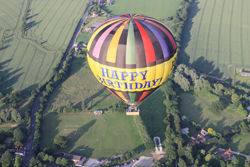 Looking down on our Happy Birthday balloon and an aerial picture of Essex by balloon